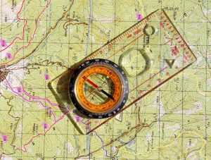 compass and topo map for backpacking