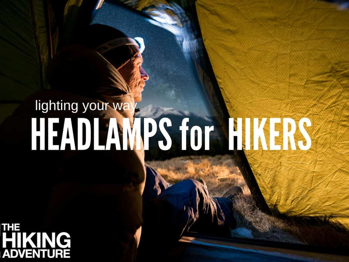 headlamp lighting up a campsite