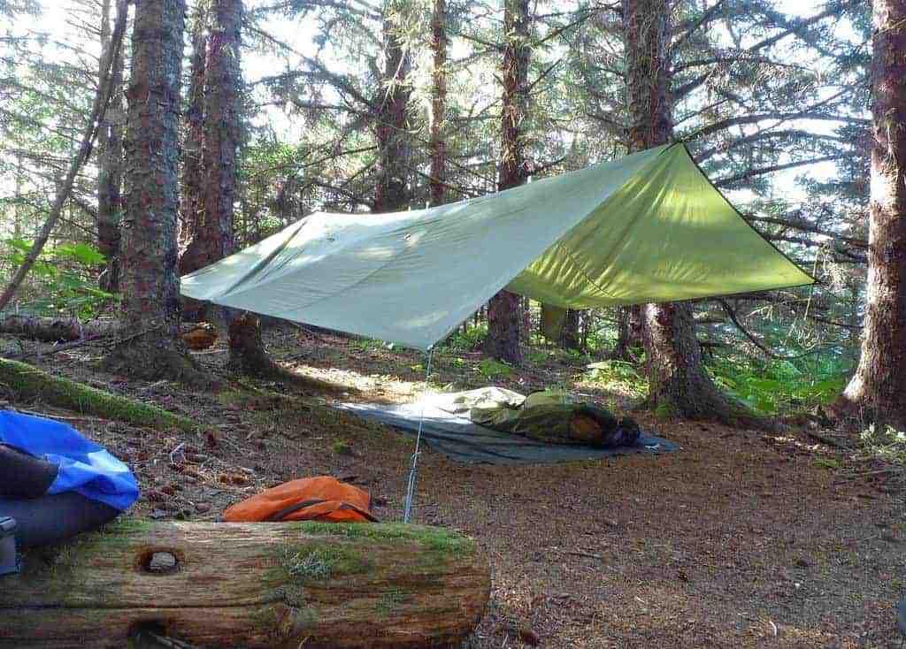 groundsheet for tarp camping should be larger than the tarp