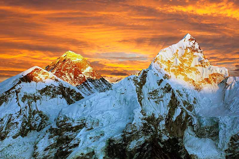 A horizontal image of sunrise over the himalayas.