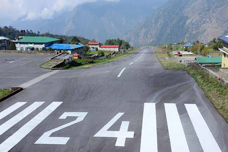 A horizontal image showing the runway at Lukla airport, Nepal.
