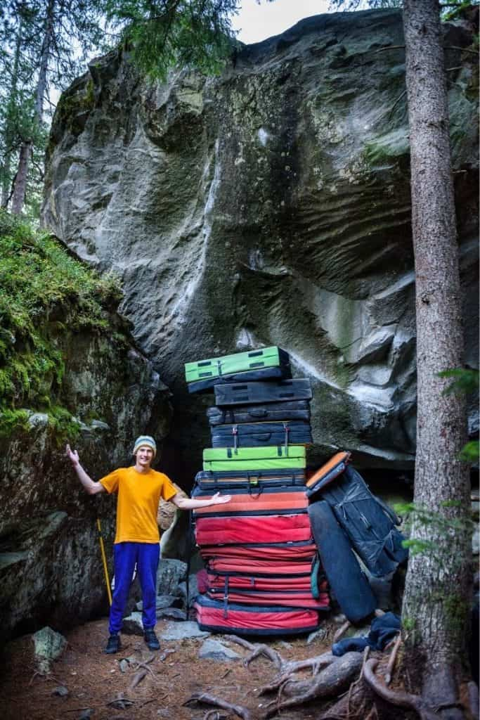 end of a successful bouldering trip-pile of crash pads