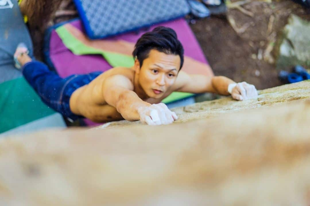chalk and crash pads are two essentials for bouldering