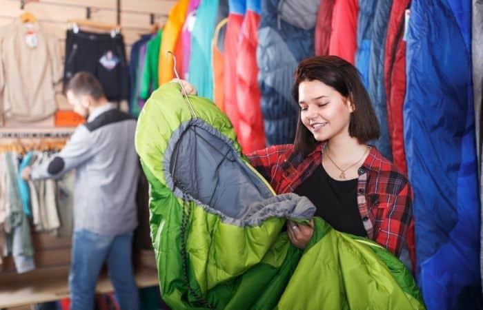 couple buying sleeping bags