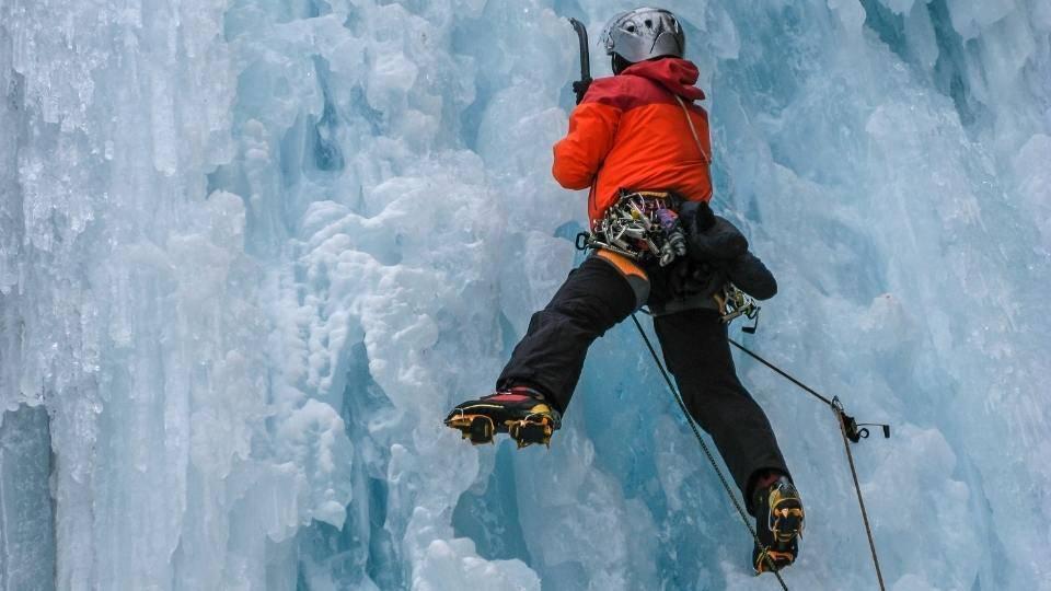 crampon digging into side of glacier