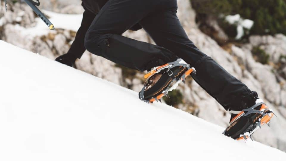 ice climbing crampons up a hill